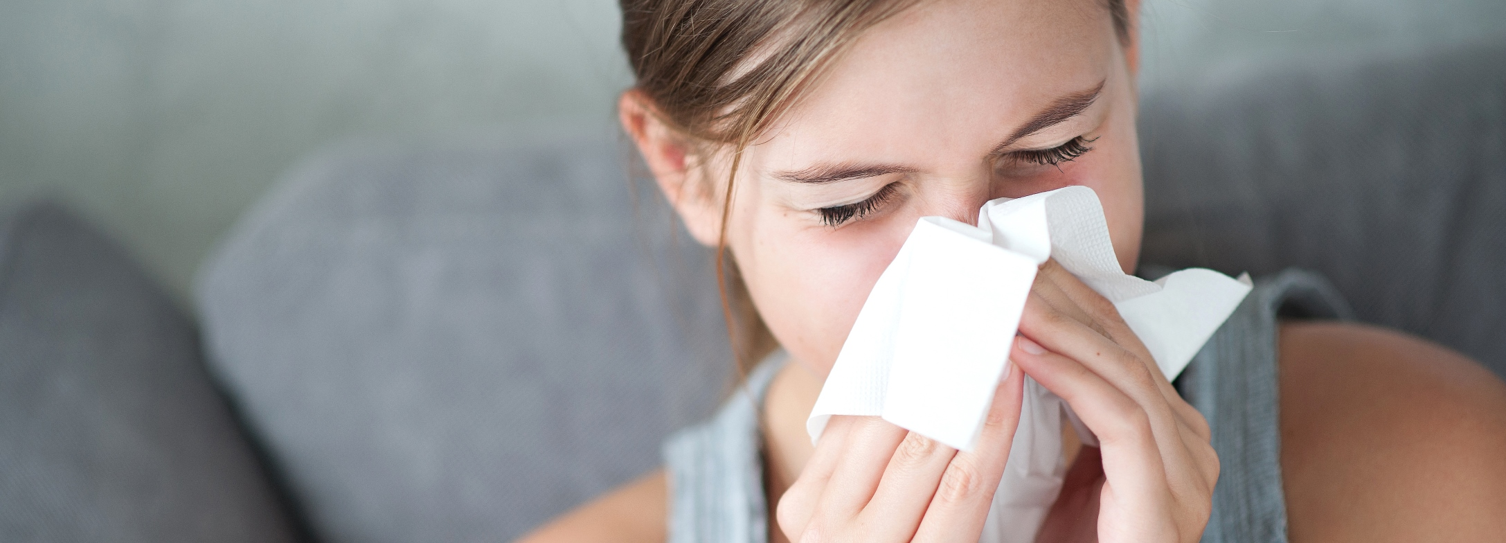 white woman flu with tissue